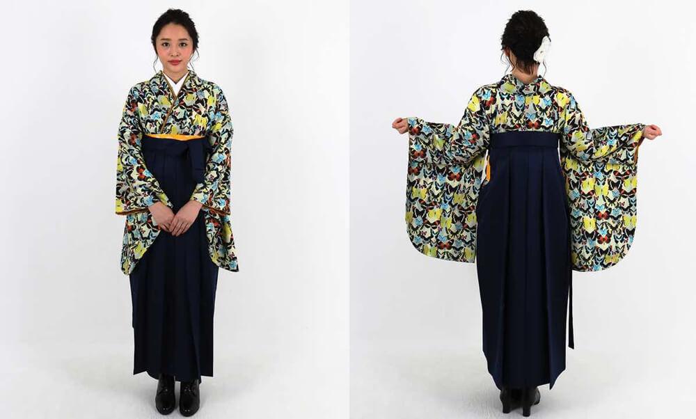 おすすめ卒業式袴レンタル | 淡黄色地にダイヤ柄 様々な蝶の総柄 紺袴_モデル