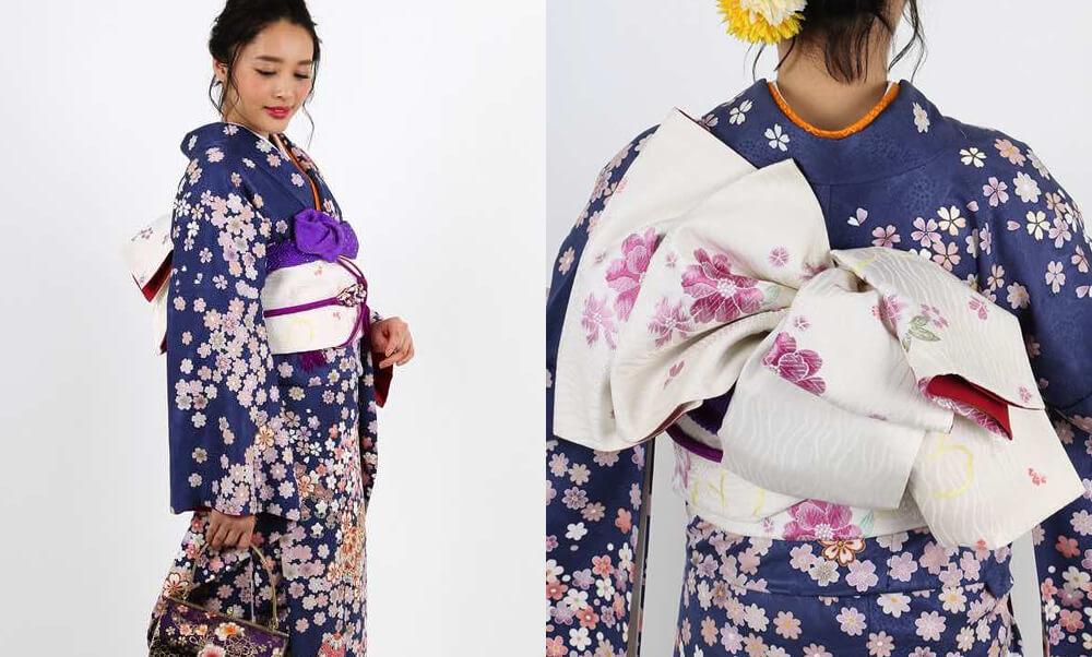 おすすめ振袖レンタル | 紺地に咲き溢れる小花と毬 モダンな振袖に白い帯と紫