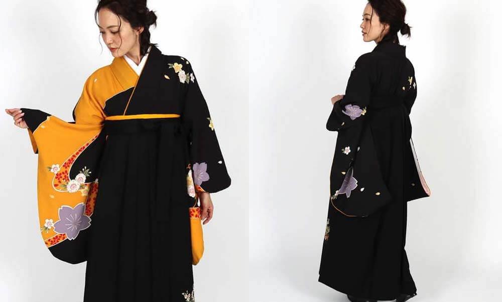 おすすめ卒業式袴レンタル | 黒×黄に桜 花と熨斗の黒袴 黒と山吹色の切り返しに桜の模様が美人度をアップ
